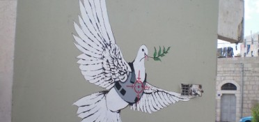 Banksy_-_Armoured_Peace_Dove-520x245